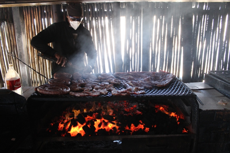 "A cook in Soweto prepares ""chisa nyama"" barbecue. Click for more."